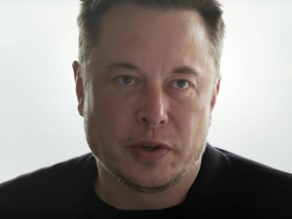 Elon Musk talked to Axios about Tesla's brush with death.