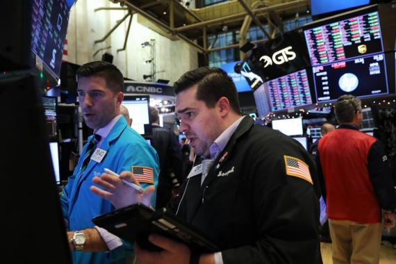 Traders work on the floor of the New York Stock Exchange earlier this week.