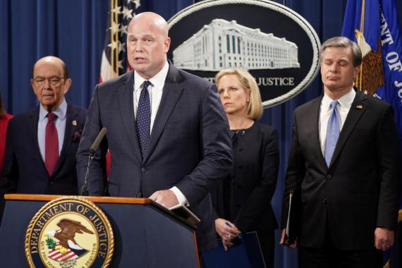 Acting Attorney General Matthew Whitaker, center.