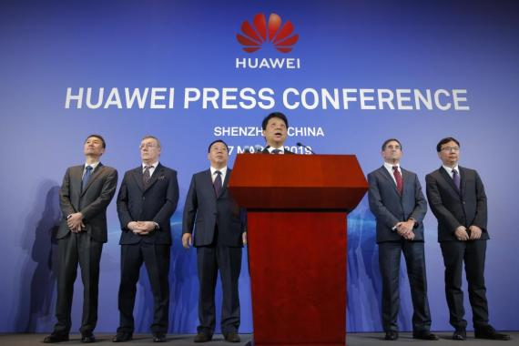 Huawei Rotating Chairman Guo Ping, center, speaks in front of other executives during a press conference in Shenzhen, China's Guangdong province.