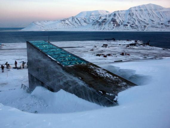 """Snow blows off the Svalbard Global Seed Vault at sunrise on, February 26, 2008. The """"doomsday"""" seed vault was built to protect millions of food crops from climate change, wars and natural disasters."""