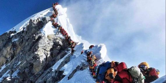 """Climbers waiting in the """"death zone"""" to summit Mount Everest."""