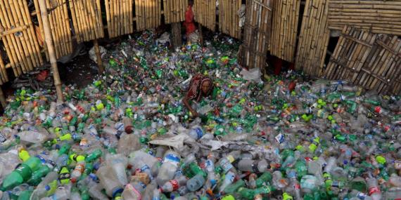 A woman working in a plastic-bottle recycling factory in Dhaka, Bangladesh, in October.
