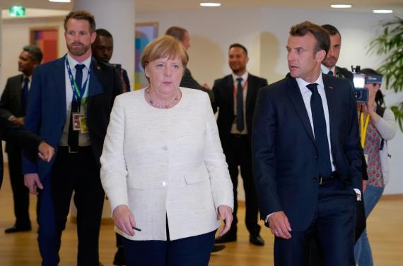 Angela Merkel, canciller de Alemania, y Emmanuel Macron, presidente de Francia, durante la Eurocumbre de Bruselas.