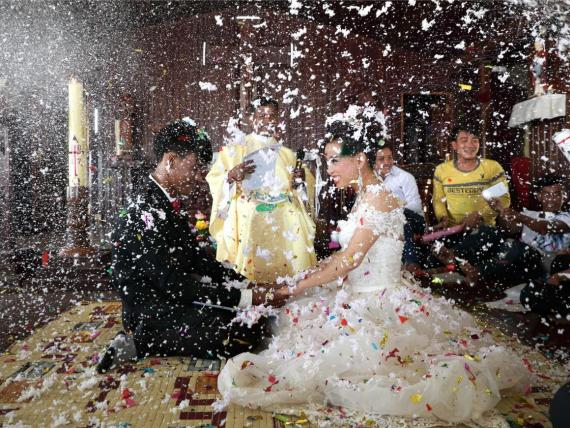 A bride and groom in Cambodia celebrate their wedding in a Catholic church.