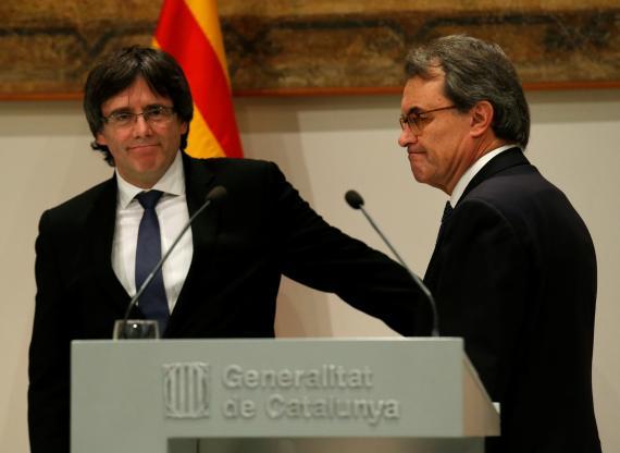 Los expresidents catalanes Carles Puigdemont y Artur Mas.