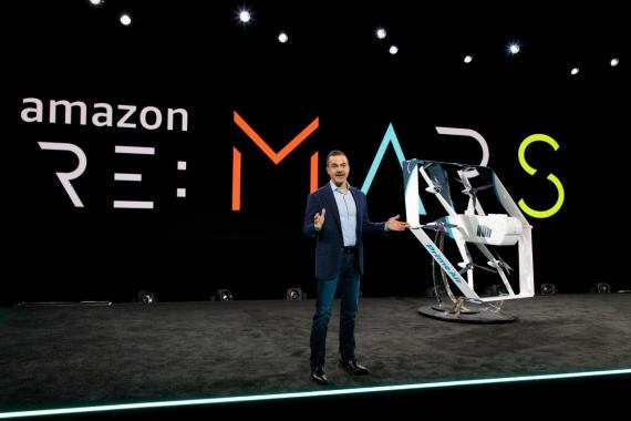 Jeff Wilke, Amazon's worldwide consumer CEO, shows off Amazon's Prime Air delivery drone.