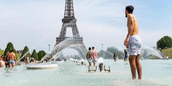 Tourists and Parisians bathe at the foot of the Eiffel Tower in the water of the Trocadero fountain to cool down on Monday.