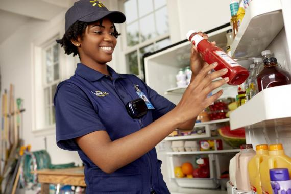A new program has Walmart workers delivering groceries straight to your fridge when you aren't home.