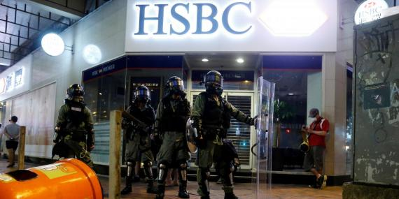 Riot police outside a HSBC bank in Hong Kong on August 11, 2019.