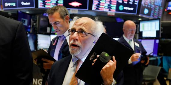Trader Peter Tuchman works on the floor of the New York Stock Exchange, Monday, July 8, 2019.