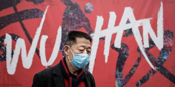 A man wears a mask while walking in the street in Wuhan, Hubei province, China.