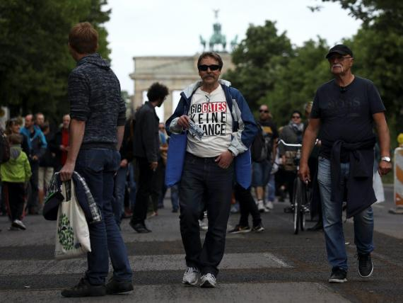 """A demonstrator shows the slogan """"don't give Gates a chance"""" during a protest against the government's restrictions following the coronavirus disease (COVID-19) outbreak, in Berlin, Germany, May 23, 2020."""