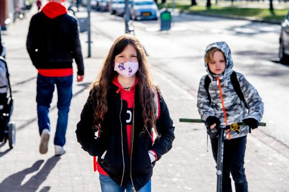 A kid attends school in the Netherlands while wearing a face mask on May 14, 2020.