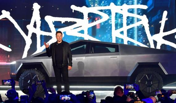 Musk introduces the newly unveiled all-electric battery-powered Tesla Cybertruck in 2019.