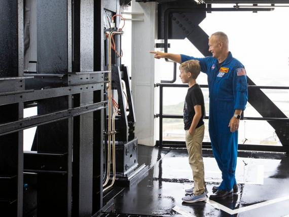 NASA astronaut Doug Hurley shows his son, Jack, around Launch Complex 39A at Kennedy Space Center on May 26, 2020.