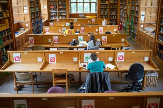Academics study in the socially distanced reading rooms at the Bodleian Libraries on August 25, 2020 in Oxford, England. The world famous libraries closed in mid-March due to the coronavirus pandemic. After putting in strict social distancing measures the