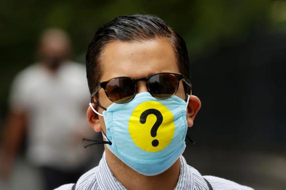 A man wears a protective face mask decorated with a question mark during coronavirus outbreak in New York, May 22, 2020. Mike Segar/Reuters