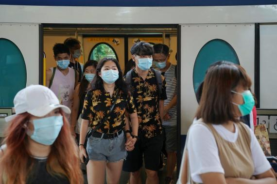 People walk out of a train at a subway station near the Hong Kong Disneyland Resort in Hong Kong, July 14, 2020. Lam Yik/Reuters