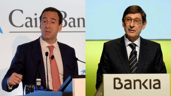 El consejero delegado de CaixaBank, Gonzalo Gortázar, y el presidente de Bankia, José Ignacio Goirigolzarri