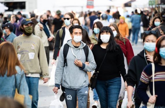 People wear face masks at the Union Square Greenmarket on September 19, 2020, in New York City.