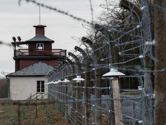 A barbed wire fence encloses the memorial site of Buchenwald near Wiemar, Germany, on January 27, 2020.