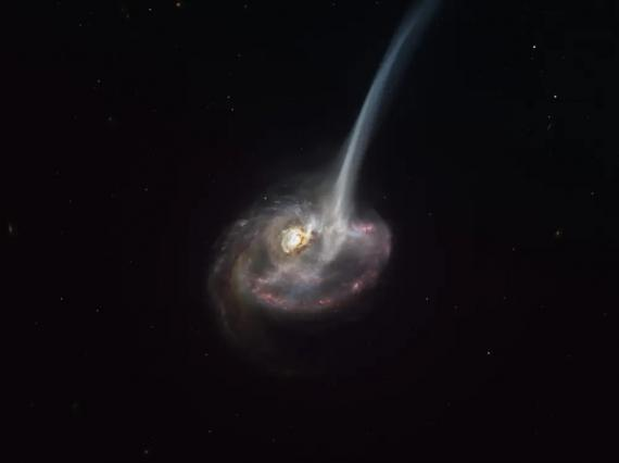 An artist's impression shows galaxy ID2299 losing a tail of gas after being formed in a galactic collision