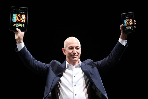 Amazon CEO Jeff Bezos holds two Kindle Fire HD devices during a press conference on September 6, 2012 in Santa Monica, California.