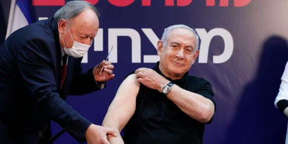 Israeli Prime Minister Minister Benjamin Netanyahu receives a coronavirus vaccine at Sheba Medical Center in Ramat Gan, Israel on Saturday, Dec. 19, 2020.