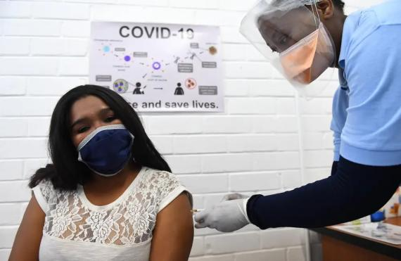 A volunteer receives an injection for a potential COVID-19 vaccine at the Baragwanath Hospital in Soweto, South Africa on June 28, 2020.