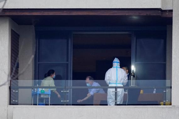 Expertos de la OMS en Wuhan investigando el origen del coronavirus.