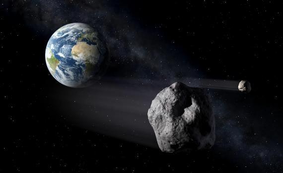 Ilustración artística de asteroides volando cerca de la Tierra.