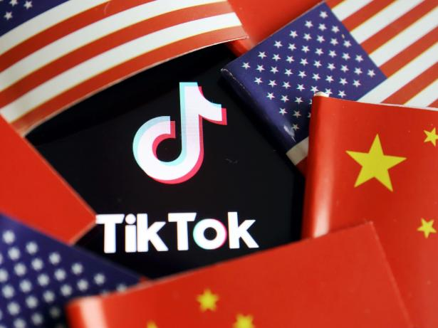 China and US flags are seen near a TikTok logo in this illustration picture taken July 16, 2020. REUTERS/Florence Lo