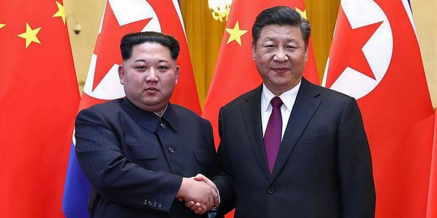 Kim Jong-un y Xi Jinping.