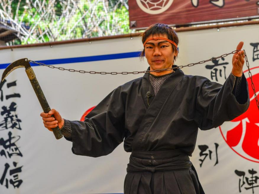 A man wearing a ninja costume and teaching at the Ninja School in Iga City, Japan.