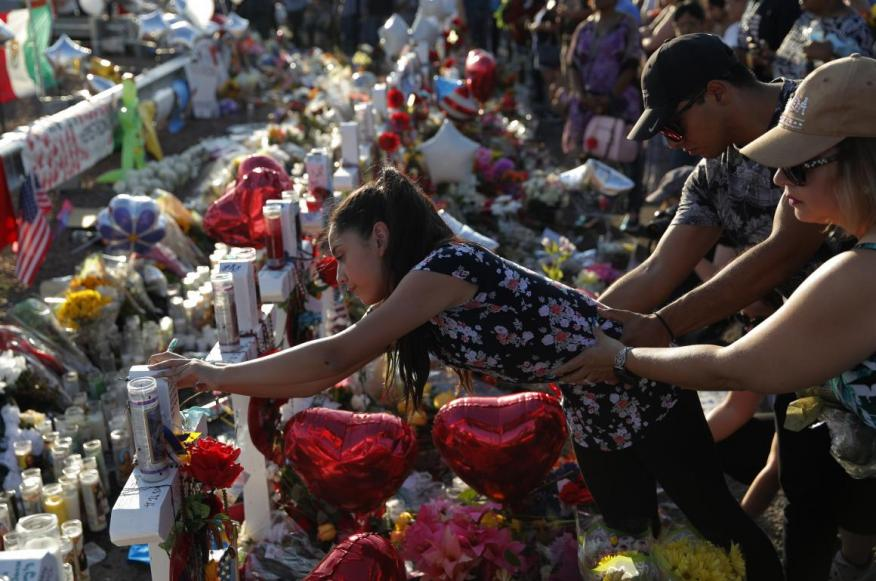 A woman at a makeshift memorial at the scene of a mass shooting in El Paso, Texas, on Tuesday.