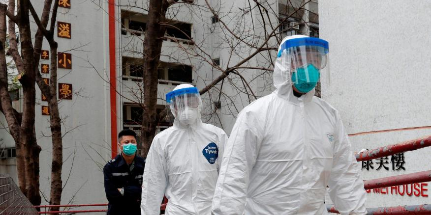 Health workers in protective gear at Cheung Hong Estate in Hong Kong in February.