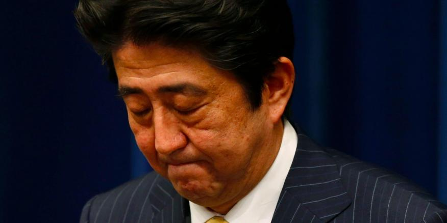 Japan's Prime Minister Shinzo Abe bows at the end of a news conference at his official residence in Tokyo June 26, 2013