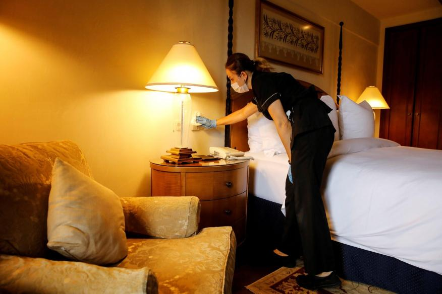 A Four Seasons Sultanahmet Hotel staff member disinfects a room in Istanbul, Turkey, on May 21, 2020.