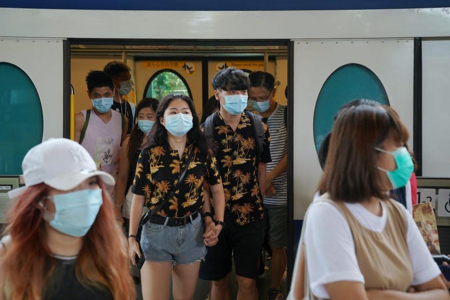 People walk out of a train at a subway station near the Hong Kong Disneyland Resort in Hong Kong, July 14, 2020. Lam Yik/Reuters